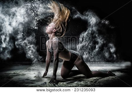Girl Dansing With Flour During Photoshoot On Black Background