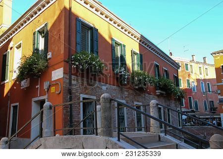Venice, Italy - August 13, 2016: Picturesque House With Flowers In Historic City Centre