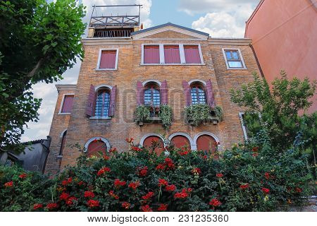 Picturesque House With Flowers In Historic Centre Of Venice, Italy