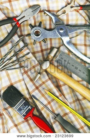 A set of tools on the workers check Shirt
