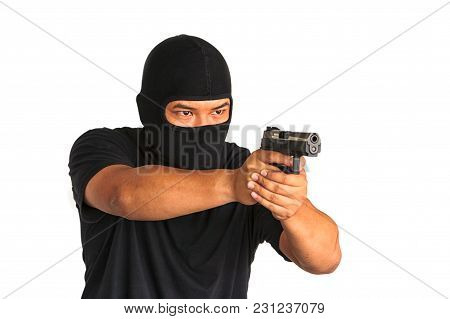 Male Criminal Aiming With His Gun At You