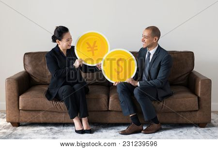 Business people holding currency icons