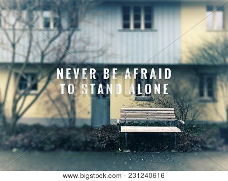 Motivational And Inspirational Quotes- Never Be Afraid To Stand Alone. With Blurred Vintage Styled B