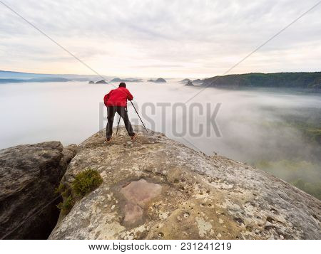 Photographer Silhouette Above A Clouds Sea, Misty Mountains.gentle Moving Clouds In Valley.