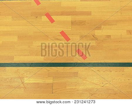 Black, White And Red Solid Or Dotted Lines In Hall Playground. Worn Out Wooden Floor Of Sports Hall