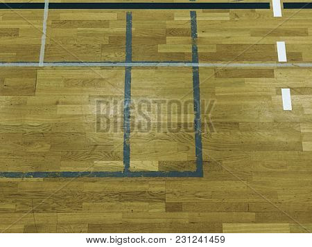 Red White Corner And Colorful Lines In Gym. Worn Out Wooden Floor Of Sporting Hall With Colorful Mar