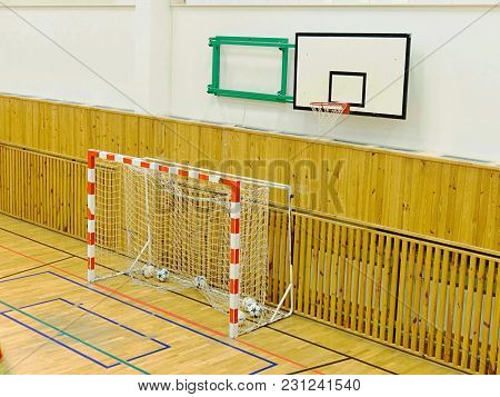 Basketball Board And Futsal Gate In School Gym.  Central Heating Covered With Wooden Panels. Renewal