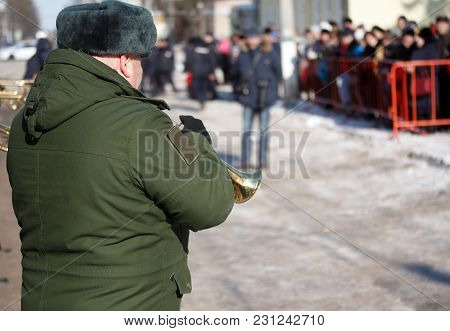Military Trumpeter At The Parade. Winter. Russia