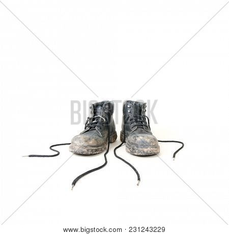 old black dirty boots on an isolated white background