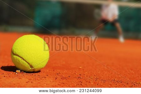 Tennis, Yellow Tennis Ball On The Ground And The Player