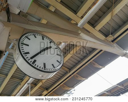 Old Clock At A Train Station, Thailand With Copy Space For Text.
