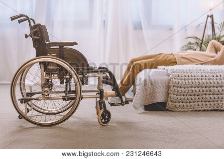 Cropped Image Of Man With Disability Lying On Bed In Bedroom