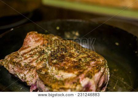 Fried Steak In A Frying Pan Big Piece Of Meat Closeup