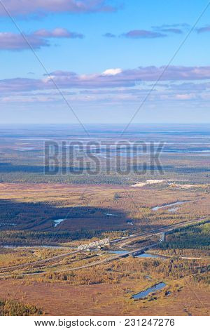 Highway And Railway Crossing The River In West Siberia In Autumn, Top View. Two Bridges Cross Forest