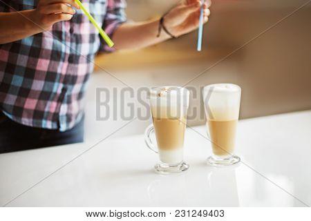 The Girl Is Preparing Morning Coffee. The Girl Is Preparing Breakfast.