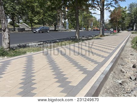 The Pedestrian Walkway Of The City Is Paved With A New Paving Slab. The Final Stage Of Repair Of The