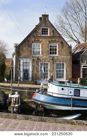 Old Small Port And Historical Houses In Puttershoek In The Netherlands