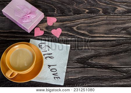 On A Wooden Background Are The Hearts With A Cup Of Coffee. Valentine's Day Concept.
