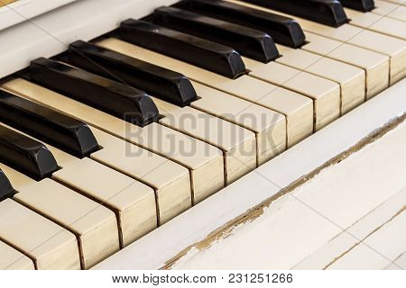 White Piano, Side View Of Instrument, Musical Instrument. Learn To Play The Instrument At Home. Whit