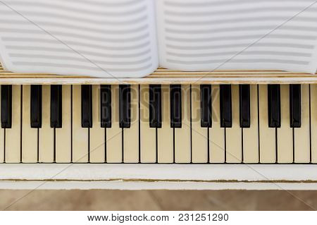 Piano Close-up, Musical Instrument. Learn To Play The Instrument At Home. White Large Piano. Piano K