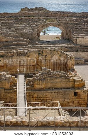 Top View Of Ancient Roman Amphitheater Near Mediterranean Sea