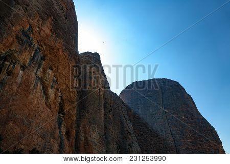 Bottom View Of High Mountain Peaks And Sun Beam