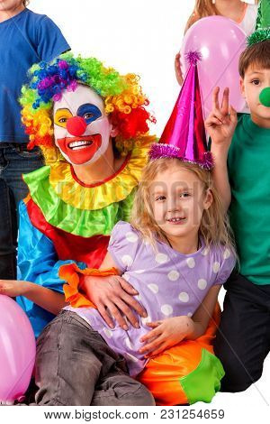 Birthday child clown playing with children and bunny fingers prank. Kid holiday cakes celebratory and balloons the happiest birthday. Holiday in primary school. Holiday for children in kindergarten.
