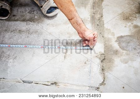 Worker Hands With A Measuring Tape, Close Up