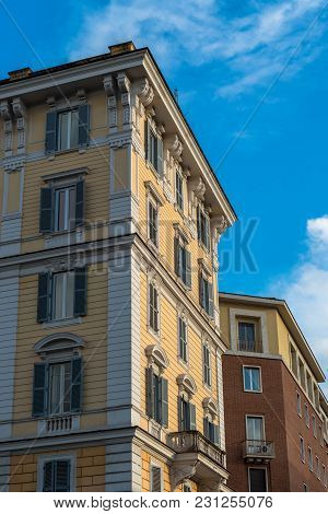 Vertical Picture Of Yellow Building In Vatican City, Italy