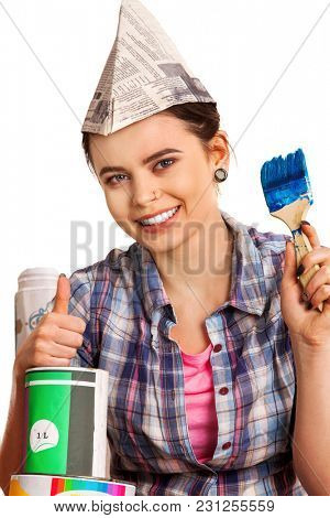 Repair home woman holding paint roller for wallpaper. Aggressive screaming girl in newspaper cap renovation apartment on isolated. Tired of work as student. Loan for housing for students.