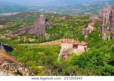 Panoramic View Of Meteora Monasteries On The High Rocks And Road In The Mountains At Spring Time, Gr