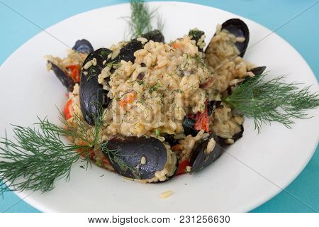 A Serving Of Risotto With Peppers, Mussels And Fresh Fennel.
