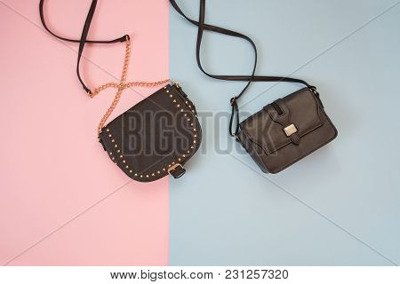 Fashionable Concept. Two Black Handbag. Tender Pink And Blue Background.