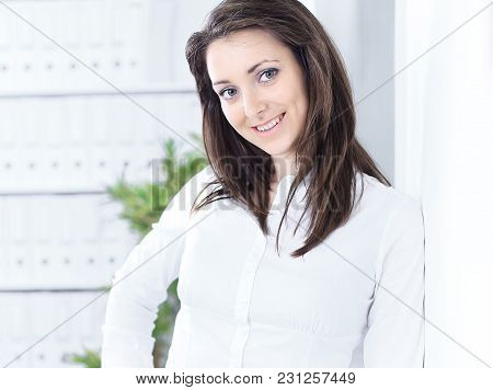 Portrait Of An Employee Of The Company Standing In The Office