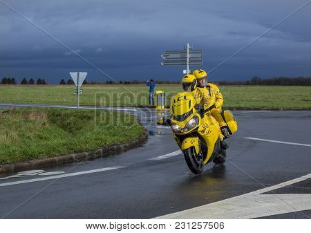 Cernay-la-ville, France - March 5, 2017: The Yellow Lcl Bike Driving On A Wet Road During The First