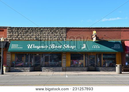 CODY, WYOMING - JUNE 24, 2017: Waynes Boot Shop is one of the shops on Sheridan Avenue in Cody, Wyoming.