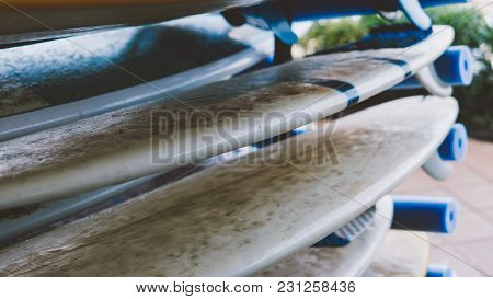 All Sizes Surfboards Close-up. Surf Camp And Boards Of Different Sizes For Surfing