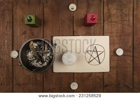 Overhead Photo Of Cauldron, Grimoire, And Candles