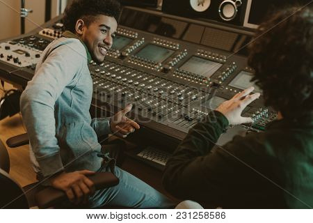 Happy Sound Producers Talking At Recording Studio