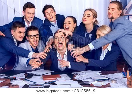 Mad business people office. Team people are unhappy with their leader. Intern woman manager does not cope with his duties. Crazy crowd in stress throw up their chief's papers. New employee in team.
