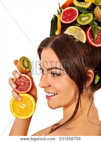 Hair mask from fresh fruits on woman head. Girl with beautiful face hold ingredient for homemade organic skin and hair therapy. Fruits are nicely laid out on palms. Best spa clinic.