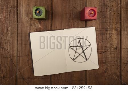 An Overhead Photo Of Two Candles And An Open Grimoire With Copy Space