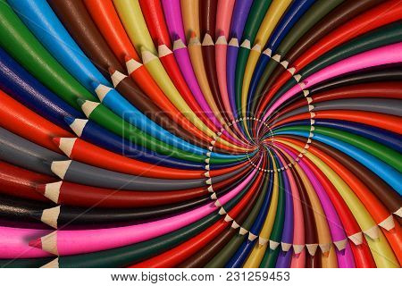 Colorful Rainbow Sharpen Pencils Spiral Background Pattern Fractal. Pencils Twisted Background Patte