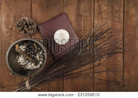 Overhead Photo Of Cauldron, Grimoire, Candle, And A Broom