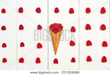 Top View Of One Waffle Cone With Sweet Organic Raspberries Between Raspberry Rows, Free Space. Fresh