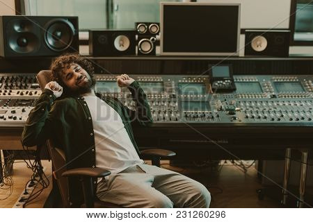 Happy Tired Sound Producer Stretching In Studio