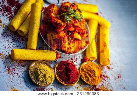 Indian Appetizer Dish I.e.teekha Laal Batata Or Spicy Potato With  All Its Ingredients And Spices On