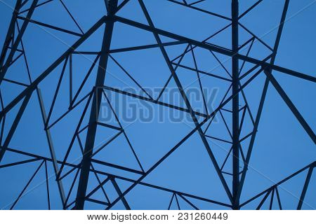 Electricity Pylon Against An Intense Blue Sky