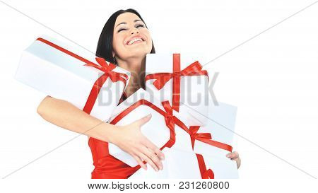 Young Happy Woman With A Gift, Closed Her Eyes With Happiness And Pleasure Isolated On A White Backg