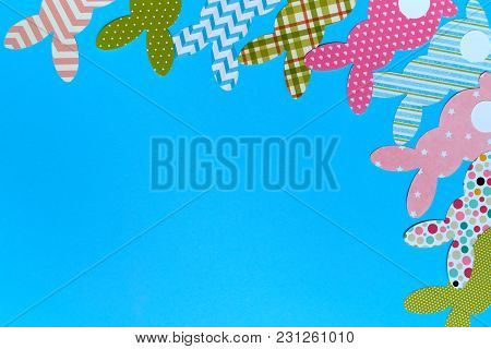 Easter Bunny Decoration On Blue Background, Copy Space. Diy Holiday Handicraft Of Colorful Rabbits.